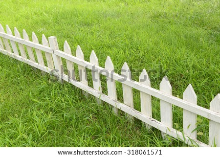 The white wooden fence in the park