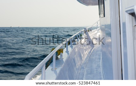 The white yacht deck during sailing on a beautiful blue sea in the summer