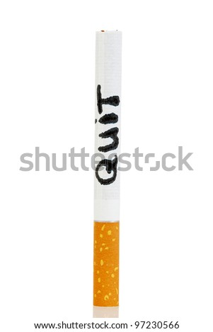 The whole cigarette with the word quit written on it on a white background - stock photo