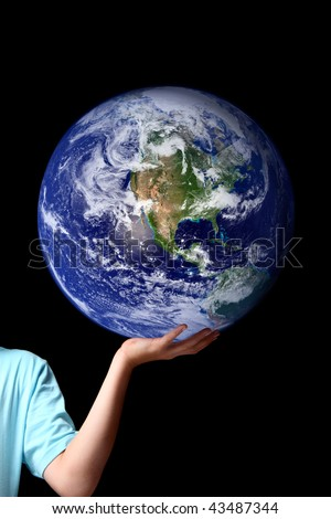 The whole earth is my birthplace and all humans are my brothers.... Kahil Gibran.  A person holds the earth in the palm of his hand.  Concept for world peace, environment issues, global issues, travel - stock photo