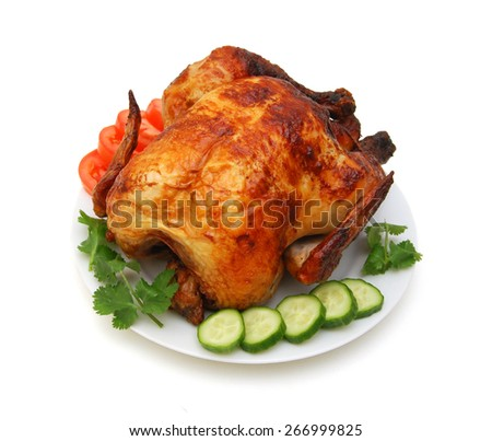 The whole fried chicken in plate on a white background - stock photo