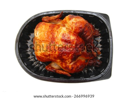The whole fried chicken in tray on a white background - stock photo