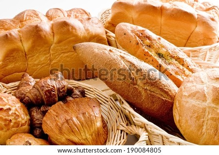The wicker baskets held different types of bread. - stock photo