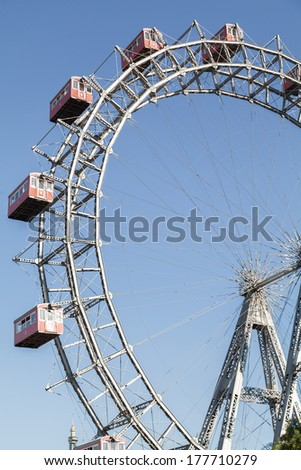 The Wiener Riesenrad is a Ferris wheel at the entrance of the Prater amusement park in Vienna, It is one of most popular tourist attractions in Vienna. Austria - stock photo