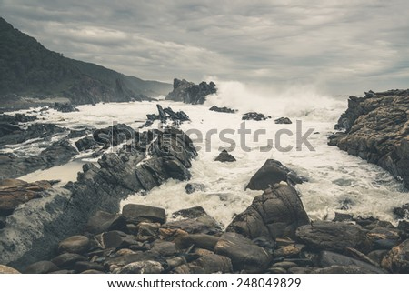 The wild coast of Tsitsikamma National Park with rocks and big waves. Eastern Cape. South Africa. - stock photo