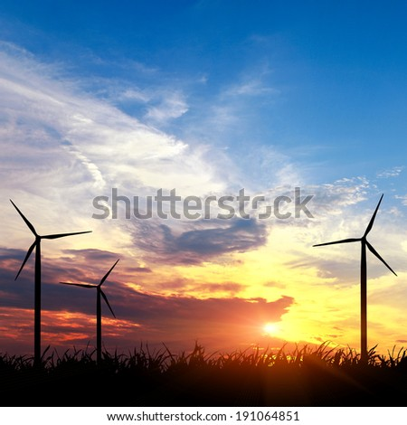 the wind electric station at the sunset - stock photo
