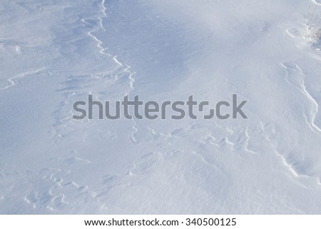 the wind on the snow made little ridges - stock photo