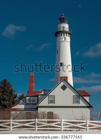 The Wind Point Lighthouse near Racine, Wisconsin stands as one of the tallest and oldest of the active lighthouses on the Great Lakes. - stock photo