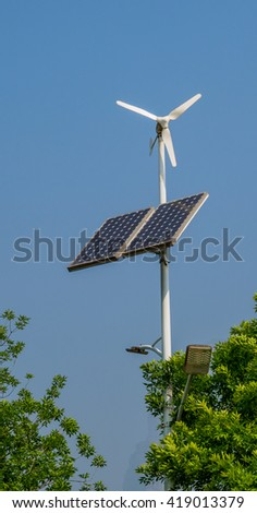 The wind turbine and solar cell that produce the electrical power - stock photo