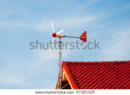 The Wind turbine on roof at home - stock photo