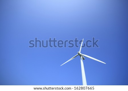 The windmill and the sun of wind power generation - stock photo