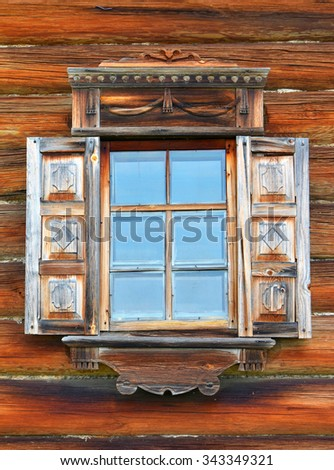 The window in traditional russian rural wooden house in Kareliya, Russia