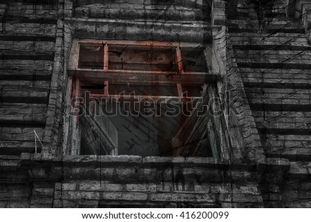 The window of the old creepy abandoned scary house  - stock photo