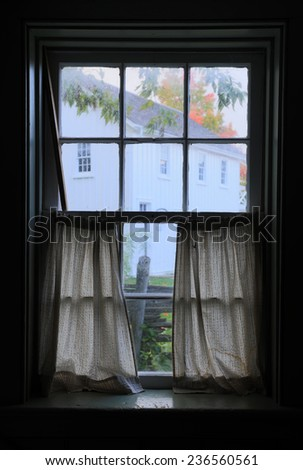 The window of the old wooden log house - stock photo