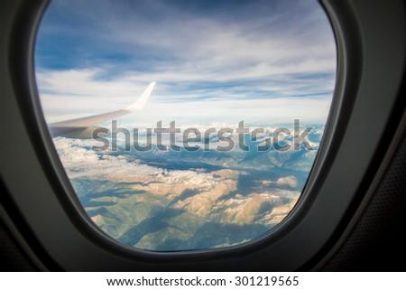 the window of the plane - stock photo