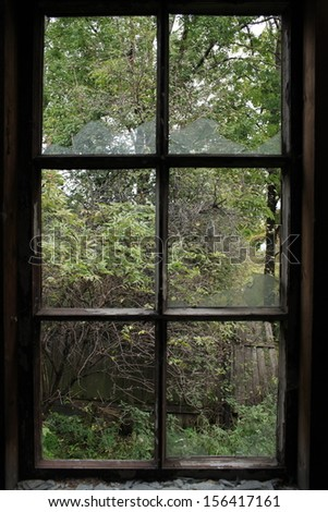 The window with the broken glass inside - stock photo