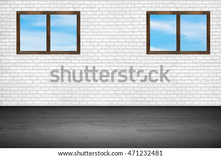 The windows in the room brick wall background.