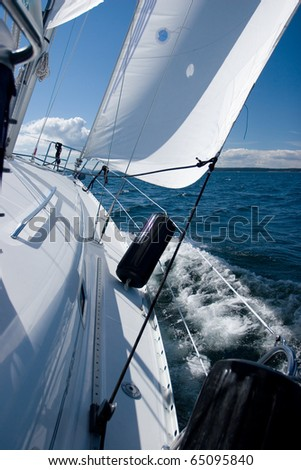 The winds of the San Juan Islands in Washington state propel this sailing yacht. - stock photo