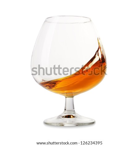 The wineglass with splashed brandy. - stock photo
