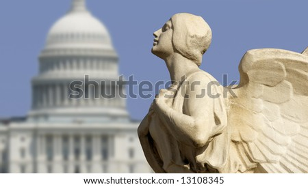 The winged figure of Democracy in front of the United States Capitol in Washington, DC. - stock photo