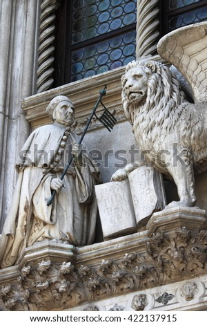 The winged lion and the doge Francesco Foscari on the Doge Palace in Venice, Italy - stock photo