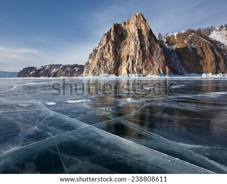 The Winter's Tale Baikal - pure ice, rocks and reflections - stock photo