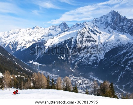 The winter view on Chamonix Mont-Blanc Valley and French Alps mountaines  from the ski slope  - stock photo