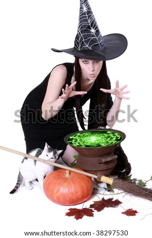 the witch expresses the incantation over its own kettle - stock photo
