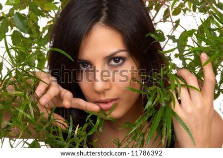 The woman among tropical plants - stock photo