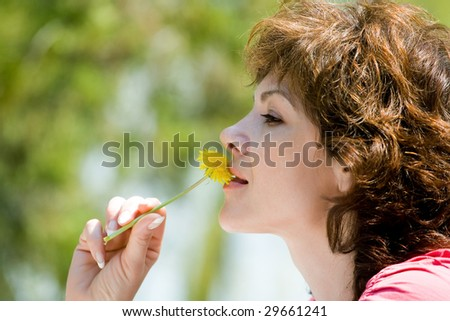 The woman and dandelions on a green background