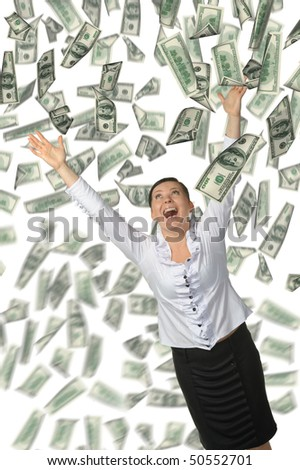 The woman and is a lot of money falling from above. It is isolated on a white background. - stock photo
