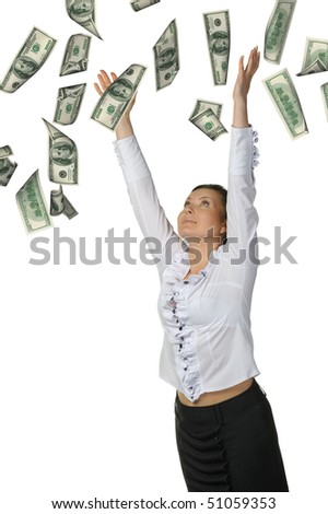 The woman and is a lot of money falling from above. It is isolated on a white background.