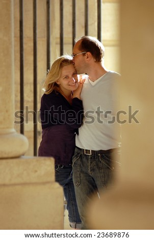 The woman and the man walk in a park. - stock photo
