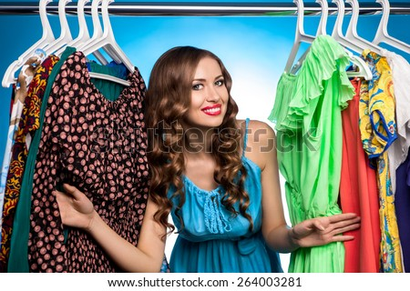 The woman at the counter with the clothes on a blue background - stock photo