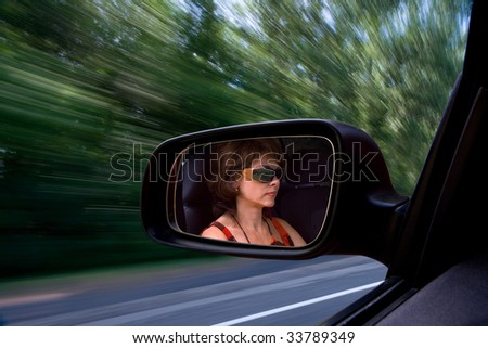 The woman at the wheel at great speed