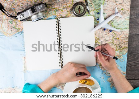 The woman blogger writing reviews about places visited in the trip. Planning travel. Thirst travel - stock photo