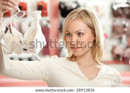 The woman chooses a brassiere among set in a boutique - stock photo