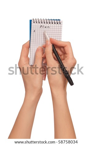 The woman creates the daily plan of action - stock photo