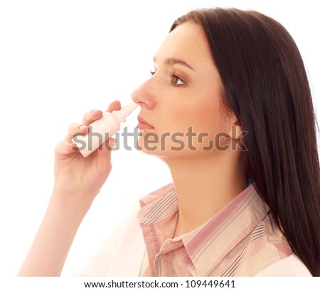 The woman drips drops for a nose for fast recover isolated on white background - stock photo