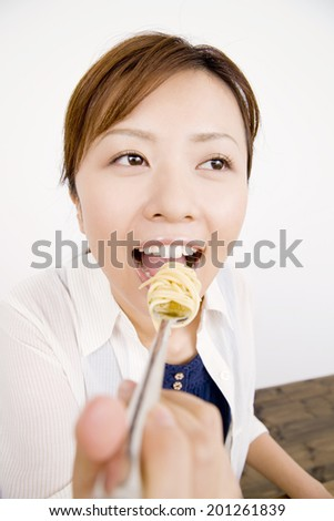 The woman eating pasta