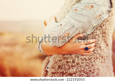 The Woman Embraces Herself Hands, Ring in the finger, outdoor - stock photo