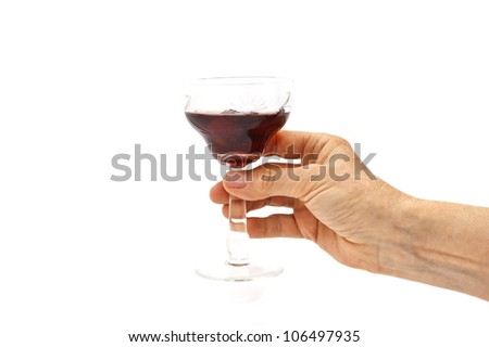 The woman holds glass with old red wine