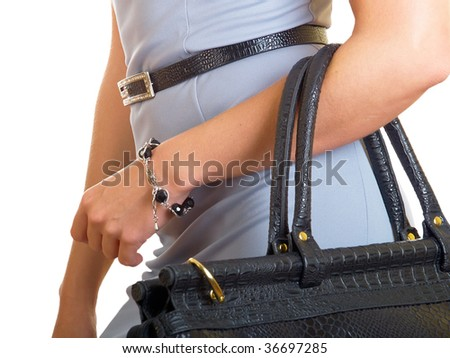 The woman in a dress bears a road bag on a hand - stock photo