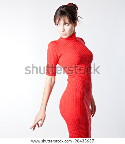 The woman in a red dress on white background