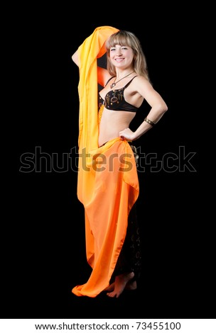 The woman in east dancing suit. Isolated on black background