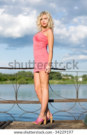 The woman in pink dress. - stock photo