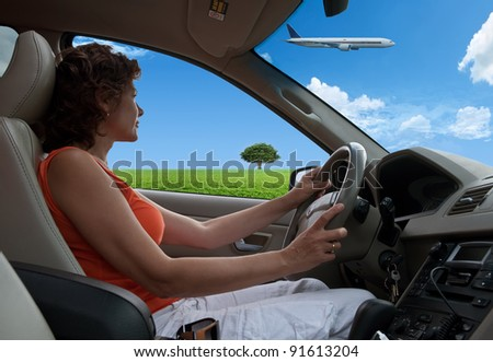 The woman in the car against the nature - stock photo