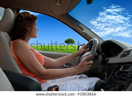 The woman in the car against the nature