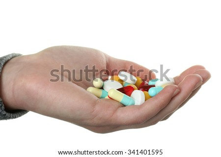 the woman in the sweater keeps in the hand of pills on white background
