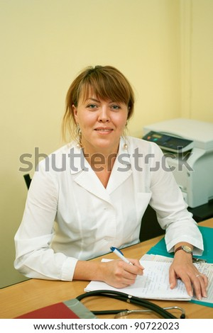The woman in white medical gown on the table. Shallow DOF - stock photo